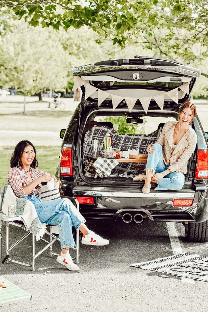 Sportsanista sharing how to build a tailgate party from your car for game day weekends