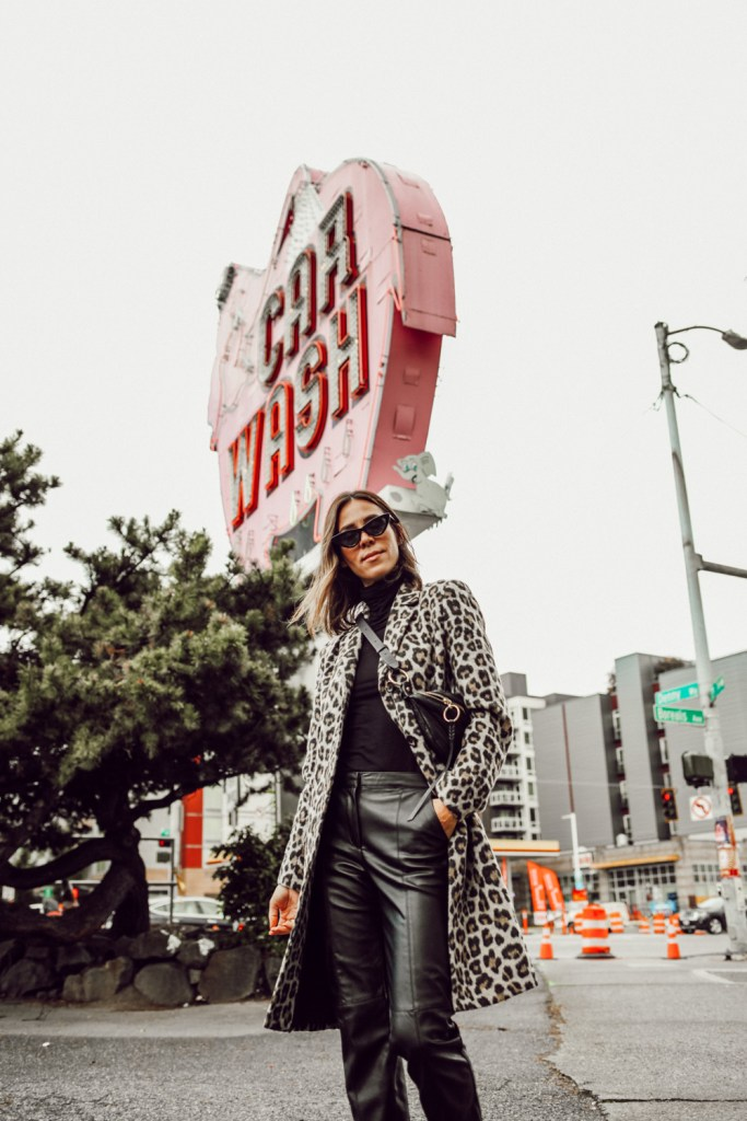 Sportsanista wearing Brushed Leopard Coat and Black Turtleneck with Faux leather Pants