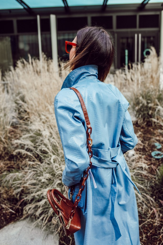 Seattle Blogger Sportsanista wearing faux leather trench and mini bag