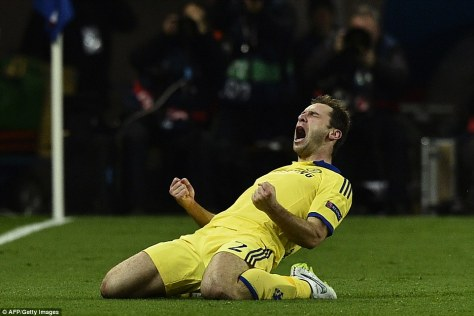 Branislav Ivanovic celebrates his goal against PSG in the UEFA Champions League. Will he and Chelsea be celebrating a Premier League title by season's end? (AFP / Getty Images)