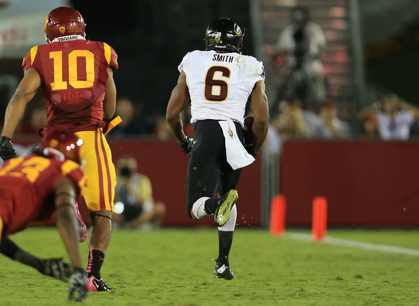 Cameron Smith with a 73-yard TD against USC in 2014 (ictor Decolongon/Getty Images North America)