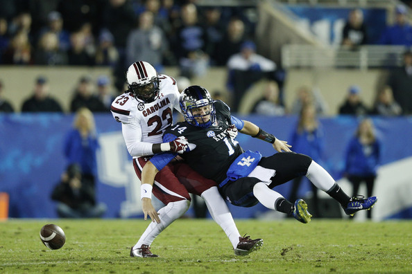 Larenz Bryant forcing a fumble against Kentucky in 2014 (Joe Robbins/Getty Images North America)