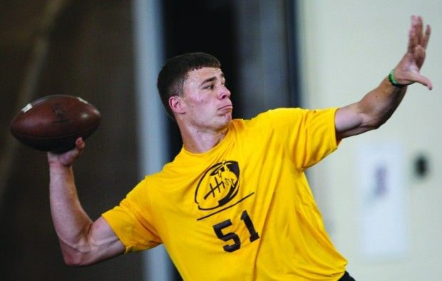 Quarterback Austin Fort practicing at Wyoming's indoor facility in the summer of 2014 (Leah Millis | Star-Tribune)