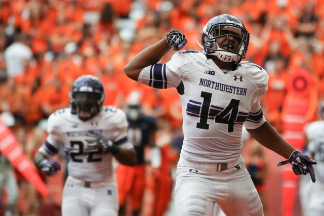 Christian Jones celebrates against Syracuse in 2014 (Andrew Renneisen / The Daily Orange)