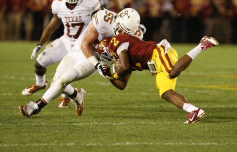 Dalton Santos makes a tackle against Iowa State in 2013 (David Purdy/Getty Images North America)