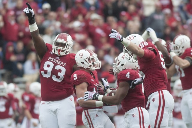 Ralph Green (#93) celebrates with teammates against Minnesota in 2013 (Indiana Daily Student)