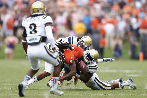 Randall Goforth against Virginia in 2014. He would pick up the fumble and return it for a touchdown (Joe Robbins/Getty Images North America)