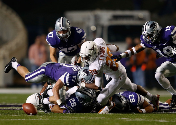 Sheroid Evans goes for a fumble against Kansas State in 2012 (Jamie Squire/Getty Images North America)