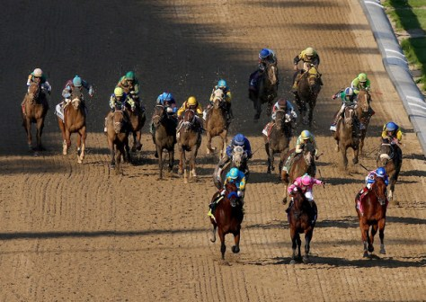 American Pharoah (#18 forefront furthest left) defeats Firing Line and Dortmund in the 2015 Kentucky Derby (Elsa/Getty Images North America)