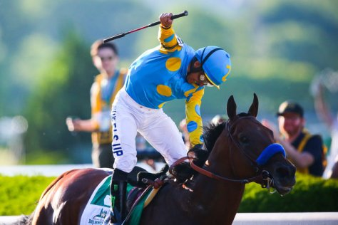 American Pharoah winning the 2015 Belmont Stakes with Victor Espinoza aboard (Chang W. Lee/The New York Times)
