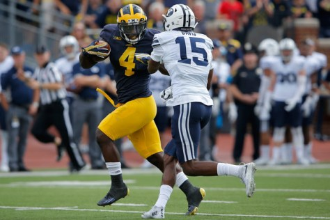 De'Veon Smith had a spectacular 60 yard touchdown run (pictured above). The defense for Michigan was also impressive. (Doug Pensinger/Getty Images North America)