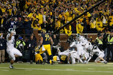 Michigan State celebrates after their improbable win against Michigan. (Christian Petersen/Getty Images North America))
