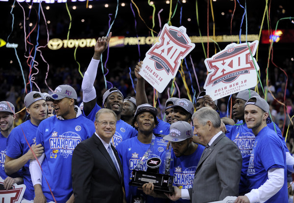Kansas Celebrates their Big 12 Championship after defeating West Virginia on Saturday, March 12, 2016. (Ed Zurga/Getty Images North America)