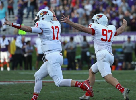 Illinois State is pictured celebrating their win over Northwestern earlier in 2016. The Redbirds were a controversial inclusion in the 2016 FCS Playoffs after an up and down regular season that ended at 6-5. They face Central Arkansas on the road in the opening round. (Jonathan Daniel/Getty Images North America)