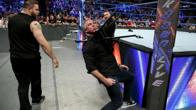 what are wwe chairs made of leather belt chair smackdown results recap brutal attack on shane mcmahon saves episode cbssports com