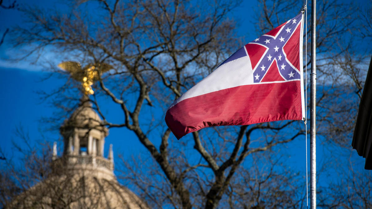 Mississippi Gov. Tate Reeves signs bill to retire last US state flag to feature the Confederate insignia.