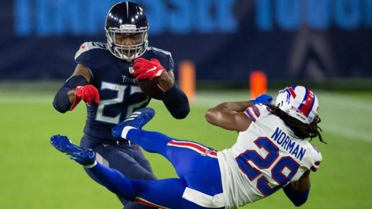 Twitter reacts to Derrick Henry's epic stiff arm on Josh Norman in Titans'  win over Bills - CBSSports.com