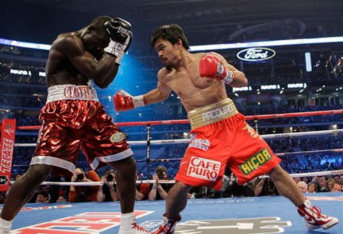 Manny Pacquiao, right, of the Philippines, hits Joshua Clottey, from Ghana, during their WBO boxing welterweight title fight in Cowboys Stadium in Arlington, Texas, Saturday, March 13, 2010.