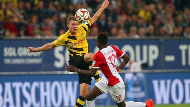 Baba Rahman in action for Augsburg vrs Dortmund