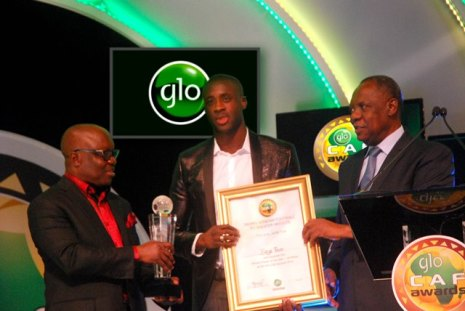 (Right to Left) CAF President, Alhaji Issa Hayatou assisted by the Delta State Governor, Dr. Emmanuel Uduaghan, decorating Yaya Toure as the 2014 African Footballer of the Year Award at the award ceremony held in Lagos, Nigeria