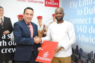the country director of emirates  airlines in a handshake with Ag. CMO of...