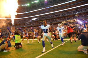 Arlington, TX - October 27, 2014 - AT&T Stadium: Dez Bryant (88) and Tony Romo (9) of the Dallas Cowboys during player introductions prior to a regular season Monday Night Football game (Photo by Scott Clarke / ESPN Images)