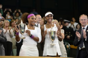 London, ENG - July 7, 2012: (L to R)Serena and Venus Williams celebrating after winning the women's doubles final during the 126th staging of the Wimbledon Championships at the All England Lawn Tennis and Croquet Club in Wimbledon (Photo by Allen Kee / ESPN Images).