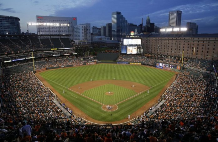 The Toronto Blue Jays and Baltimore Orioles play in the fourth inning of a baseball game, Monday, May 11, 2015, in Baltimore. It's been 25 years since the Baltimore Orioles began playing in Camden Yards, the start of a nationwide trend of major league teams moving into new ballparks. (AP Photo/Patrick Semansky)