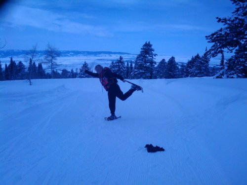 Colleen doing Yoga on snowshoes.