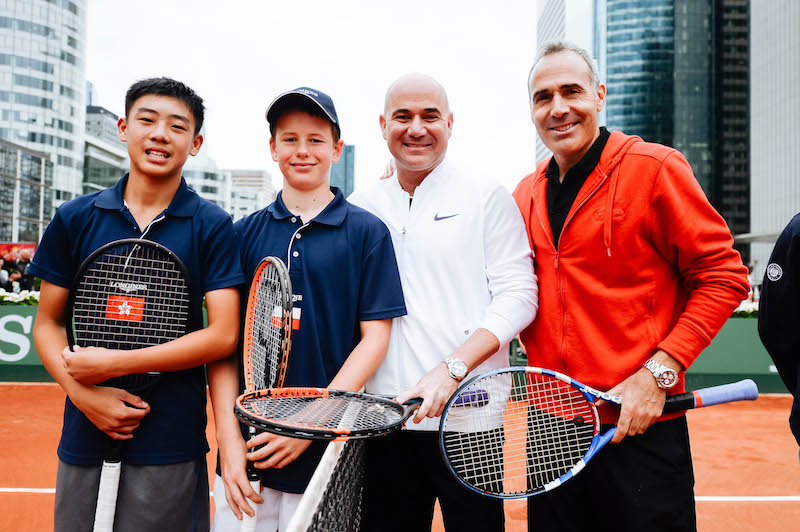 Longines Future Tennis Aces 2017 ñ Exhibition Match ñ Star players Andre  Agassi and Alex Corretja with kids ñ Honk Kong ñ Chak Lam Coleman WONG ñ and ñ Poland ñ Martyn PAWELSKI ñ La defense  ñ 2017/06/03