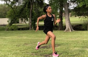 Jordynn working on her running form before the Michael Johnson Invitational at Baylor