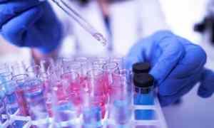 scientist using beakers