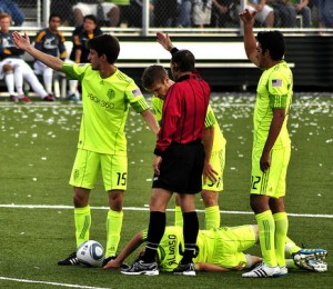 A player is injured in a Seattle Sounders match. Photo by Noelle Noble. Some rights reserved.