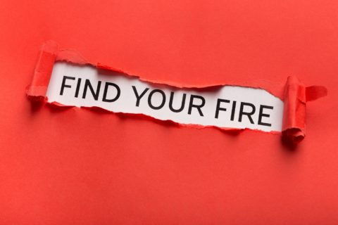 Find your fire inscription showing up behind red torn paper