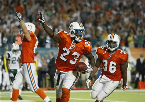 Ronnie Brown and the Dolphins ran all over the Jets last night, winning 31-27 in Miami.