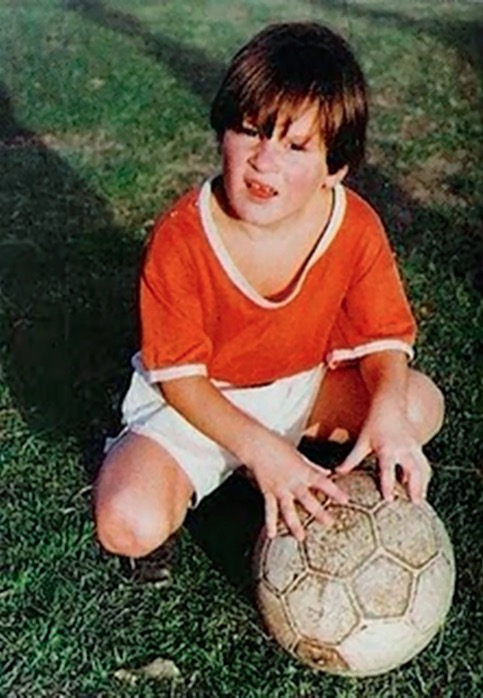 Young Lionel Messi is posing with a ball in a photo taken around 1993