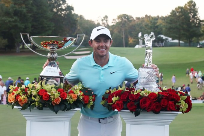 McIlroy with Tour Championship and FedEx Cup Trophies