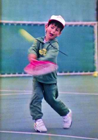Novak Djokovic playing tennis as a child