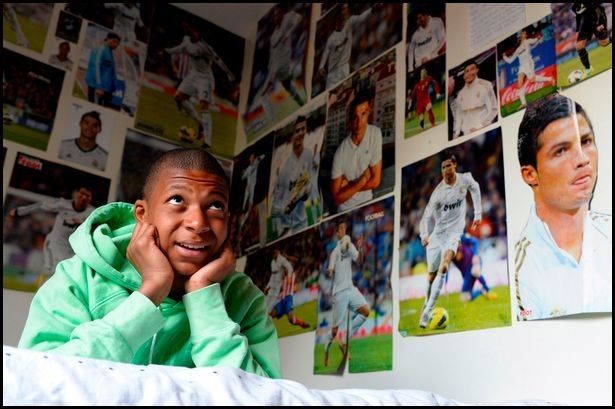 Kylian Mbappé room coverd with photos of Cristiano Ronaldo