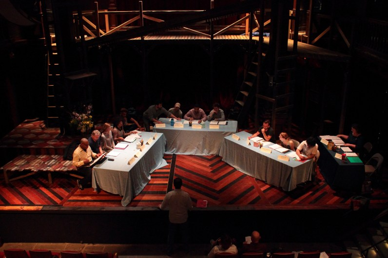 The cast of Rosencrantz and Guildenstern read through the play in the theater.