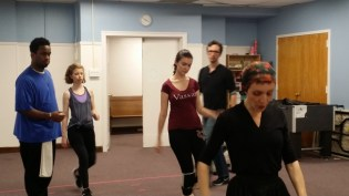 Choreographer Emma Jaster (in black) with the company
