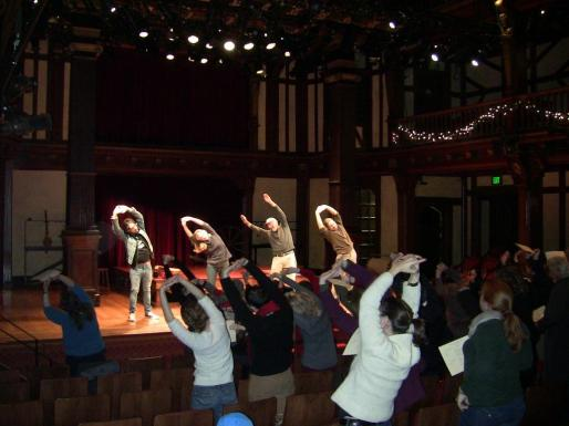 Stretching during Community Sing.