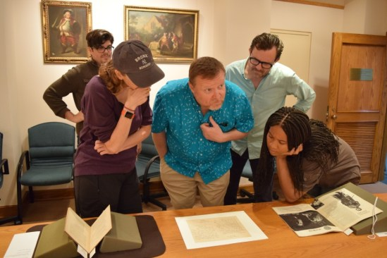 Sam Massaro, Diane Healy, Edmund Lewis, Eric Tucker, and Dria Brown look at a letter written by Shaw. Photo: Ben Lauer.