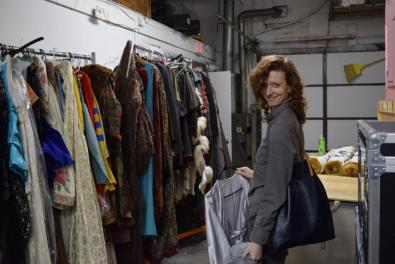 Third Rails Projects company member Elizabeth Carena visits Folger Theatre's costume storage.