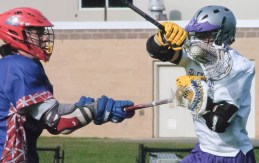 Voorheesville's Jake Palmer takes a stick shot from a Maple Hill midfielder as he tries to control the ball during a Colonial Council game Wednesday, April 13. Rob Jonas/Spotlight