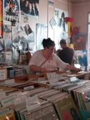 A shopper peruses the vinyl selections at the River Street Beat Shop on River Street in Troy during Troy River Fest on Saturday, June 18.