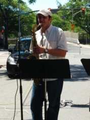 A saxophonist performs at the south end of River Street during Troy River Fest on Saturday, June 18.