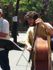 A bassist performs at the south end of River Street during Troy River Fest on Saturday, June 18.