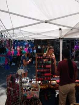 A consumer converses with one of the craft vendors during Troy River Fest on Saturday, June 18.