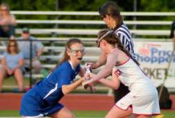 Shaker and Guilderland get ready for another center draw during the first half. Rob Jonas/Spotlight